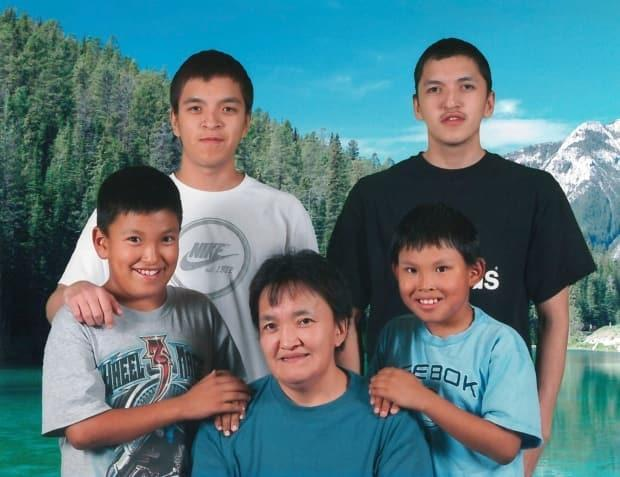 Edward Snowshoe, top right, from Fort McPherson, N.W.T., died by suicide at Edmonton Institution, a maximum-security federal prison, after spending 162 days in segregation. Corrections officers say they were not aware of his three previous suicide attempts at a prison in Manitoba. (Effie Snowshoe - image credit)