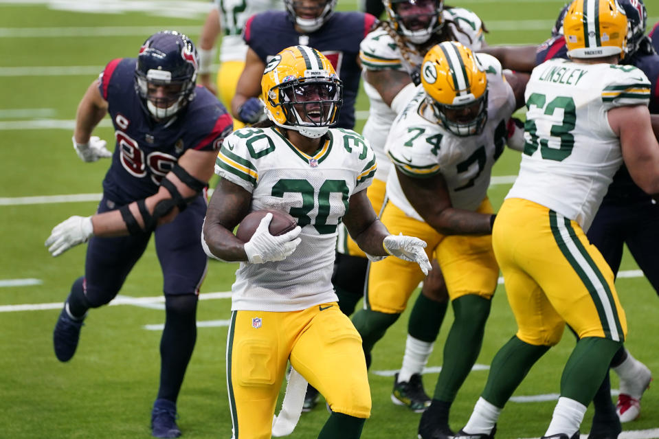 Green Bay Packers running back Jamaal Williams (30) scores during the second half of an NFL football game against the Houston Texans Sunday, Oct. 25, 2020, in Houston. (AP Photo/Sam Craft)