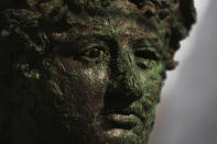 A Dionysus bust is displayed at the museum Antiquarium, in Pompeii, southern Italy, Monday, Jan. 25, 2021. Decades after suffering bombing and earthquake damage, Pompeii's museum is back in business, showing off exquisite finds from excavations of the ancient Roman city. Officials of the archaeological park of the ruins of the city destroyed in 79 A.D. by the eruption of Mount Vesuvius inaugurated the museum on Monday. (AP Photo/Gregorio Borgia)