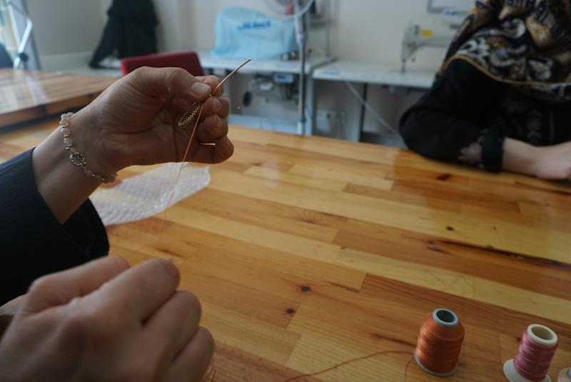 Learning how to make earrings at Small Projects.