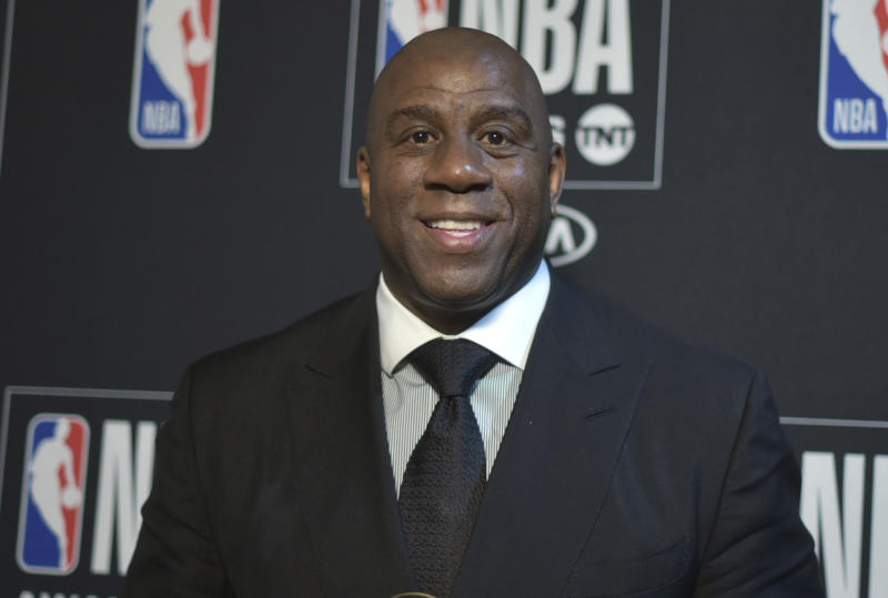 Magic Johnson poses in the press room with the lifetime achievement award at the NBA Awards on Monday, June 24, 2019, at the Barker Hangar in Santa Monica, Calif. (Photo by Richard Shotwell/Invision/AP)