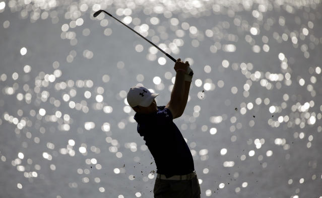 Jordan Spieth hits off the fairway on the 17th hole during the second round of play in the Tour Championship golf tournament at East Lake Golf Club in Atlanta, Friday, Sept. 20, 2013. (AP Photo/David Goldman)
