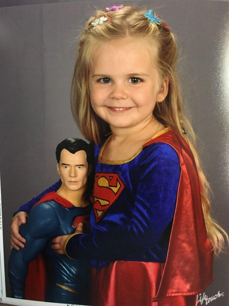 Little Girl Dresses as Superman for School Picture Day
