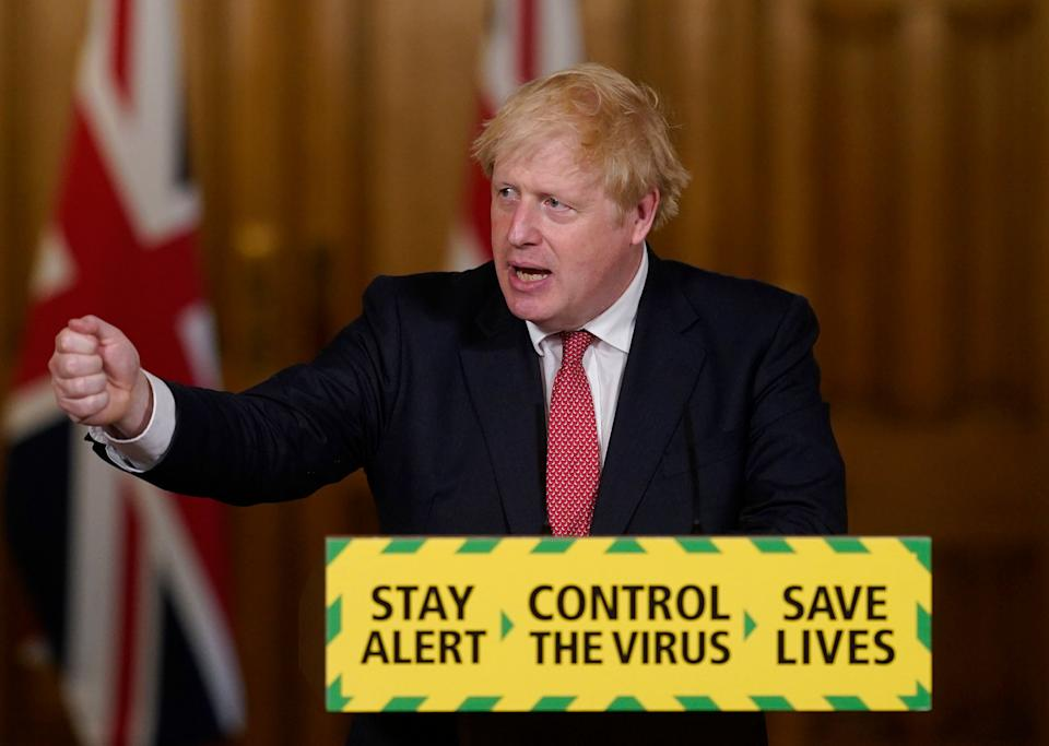 <strong>Boris Johnson speaks during a media briefing on coronavirus in Downing Street.</strong> (Photo: ASSOCIATED PRESS)