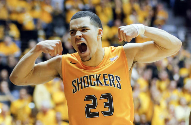 FILE - In this Feb. 22, 2014, file photo, Wichita State's Fred VanVleet flexes his muscles after making a basket against Drake during an NCAA college basketball game in Wichita, Kan. Bookmakers in Las Vegas have been watching the 31-0 Shockers win game after game this season with mounting anxiety as the NCAA tournament approaches. Although the Shockers were coming off a Final Four appearance as a No. 9 seed last spring and returned many of its players, bookmakers gave them long odds to win the national championship this year. (AP Photo/The Wichita Eagle, Travis Heying) LOCAL TV OUT; MAGS OUT; LOCAL RADIO OUT; LOCAL INTERNET OUT