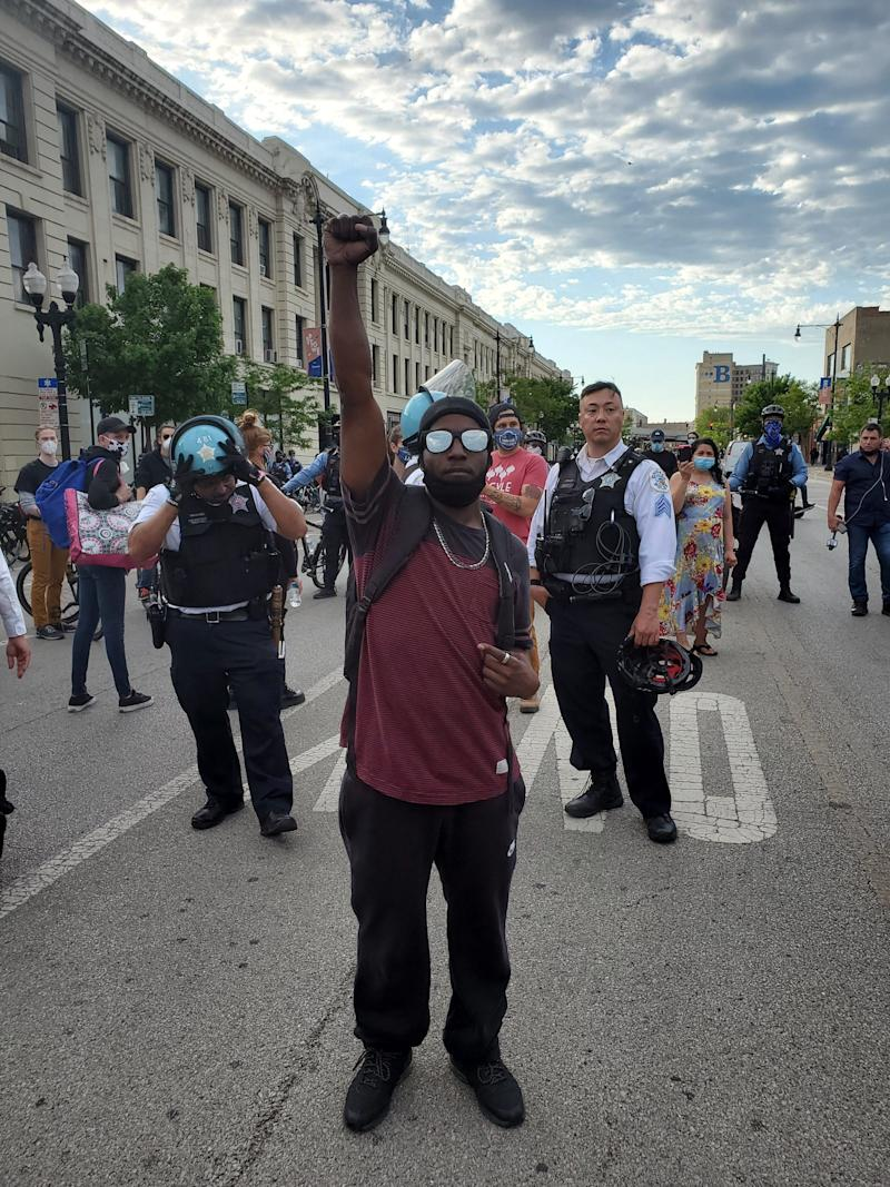 Cam O'Kelly stands in front of police officers in Chicago's Uptown neighborhood on June 1, 2020.