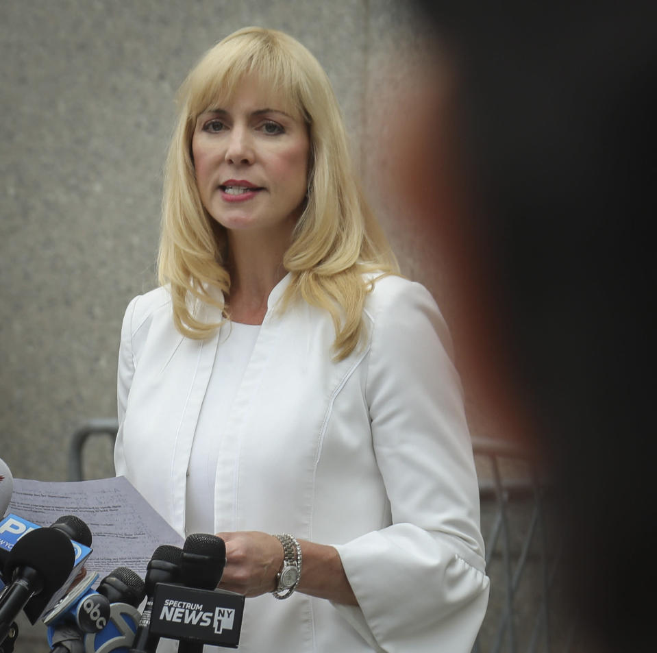 Victim lawyer Sigrid McCawley address media after leaving a hearing at Manhattan Federal Court, Monday July 8, 2019, in New York, for financier Jeffrey Epstein, was arrested in New York on sex trafficking charges. (AP Photo/Bebeto Matthews)