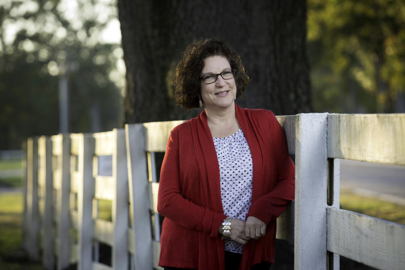 """In this Nov. 12, 2013 photo, Diane LeBlanc, 50, poses for a photograph her office in Baton Rouge, La. LeBlanc lost 40 pounds since joining """"Heads Up"""" , a supervised weight loss assistance program, provided by the Pennington Biomedical Research Center and the Louisiana Office of Group Benefits. (AP Photo/Tim Mueller)"""