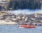Helicopter carrying 13 crashes off Norway, no sign of survivors