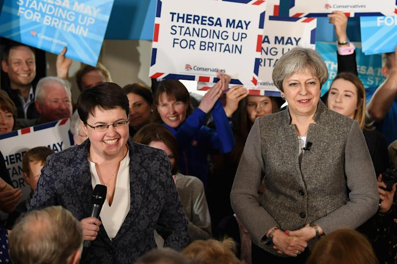 Ms Davidson and Ms May campaign together to urge Scottish people to vote Tory: Getty