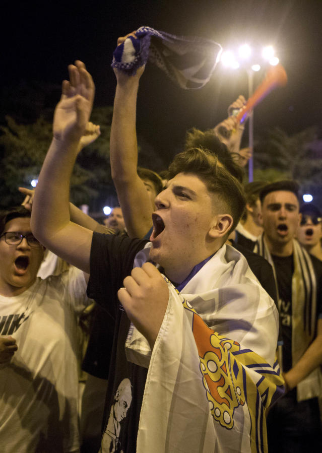 Real Madrid fans celebrate in downtown Madrid, Spain, Saturday, May 26, 2018. Real Madrid defeated Liverpool in Kiev, Ukraine, to win the Champions League soccer match final. (AP Photo/Paul White)