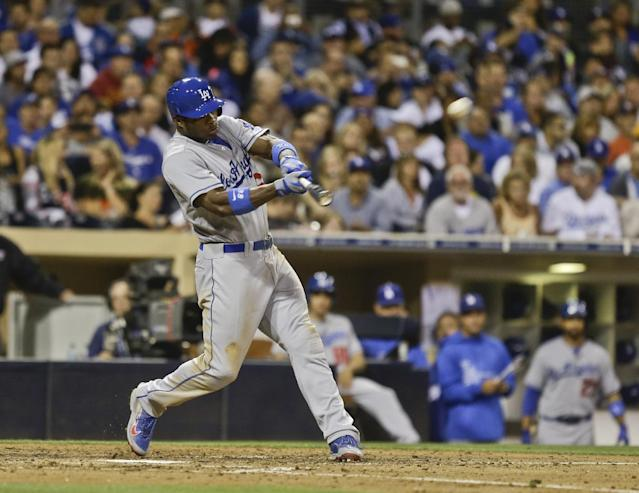 Los Angeles Dodgers' Yasiel Puig hits a two-run homer to center field against the San Diego Padres in the seventh inning of a baseball game Saturday, Sept. 21, 2013, in San Diego. (AP Photo/Lenny Ignelzi)
