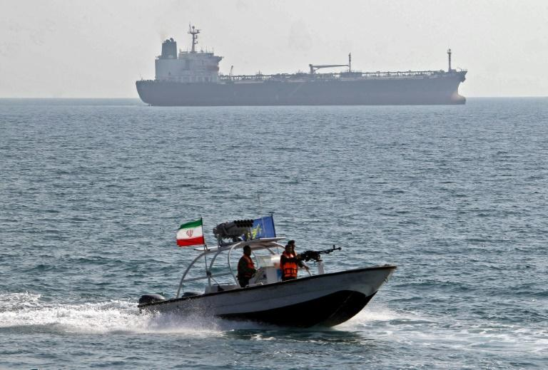 Any US strike on Iran would likely send oil prices soaring and raise tensions for oil tankers passing by Iran in the Strait of Hormuz (AFP Photo/ATTA KENARE)