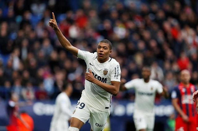 Monaco's forward Kylian Mbappe Lottin celebrates after scoring a goal during the French L1 football match against Caen (SMC) March 19, 2017 (AFP Photo/CHARLY TRIBALLEAU)