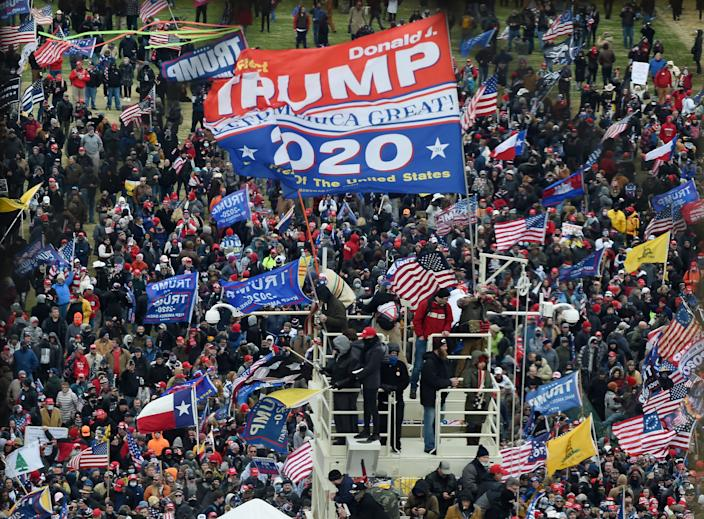 Supporters of US President Donald Trump take over stands set up for the presidential inauguration as they protest at the US Capitol in Washington, DC, January 6, 2021.  (Olivier Douliery/AFP via Getty Images)