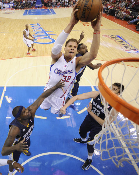 Los Angeles Clippers forward Blake Griffin, second from left, goes up for a shot as Memphis Grizzlies forward Zach Randolph, left, and center Marc Gasol, right, of Spain, defends while guard Tony Allen looks on during the first half of Game 1 of a first-round NBA basketball playoff series Los Angeles, Saturday, April 20, 2013. (AP Photo/Chris Carlson)