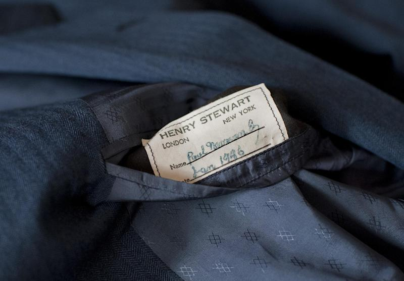 """A tailor's tag with the name """"Paul Newman"""" is seen on a suit found by Peter Gamlen in the basement of his apartment in New Haven, Conn., Tuesday, Oct. 9, 2012. Gamlen believes the suit belonged to the actor. (AP Photo/Jessica Hill)"""