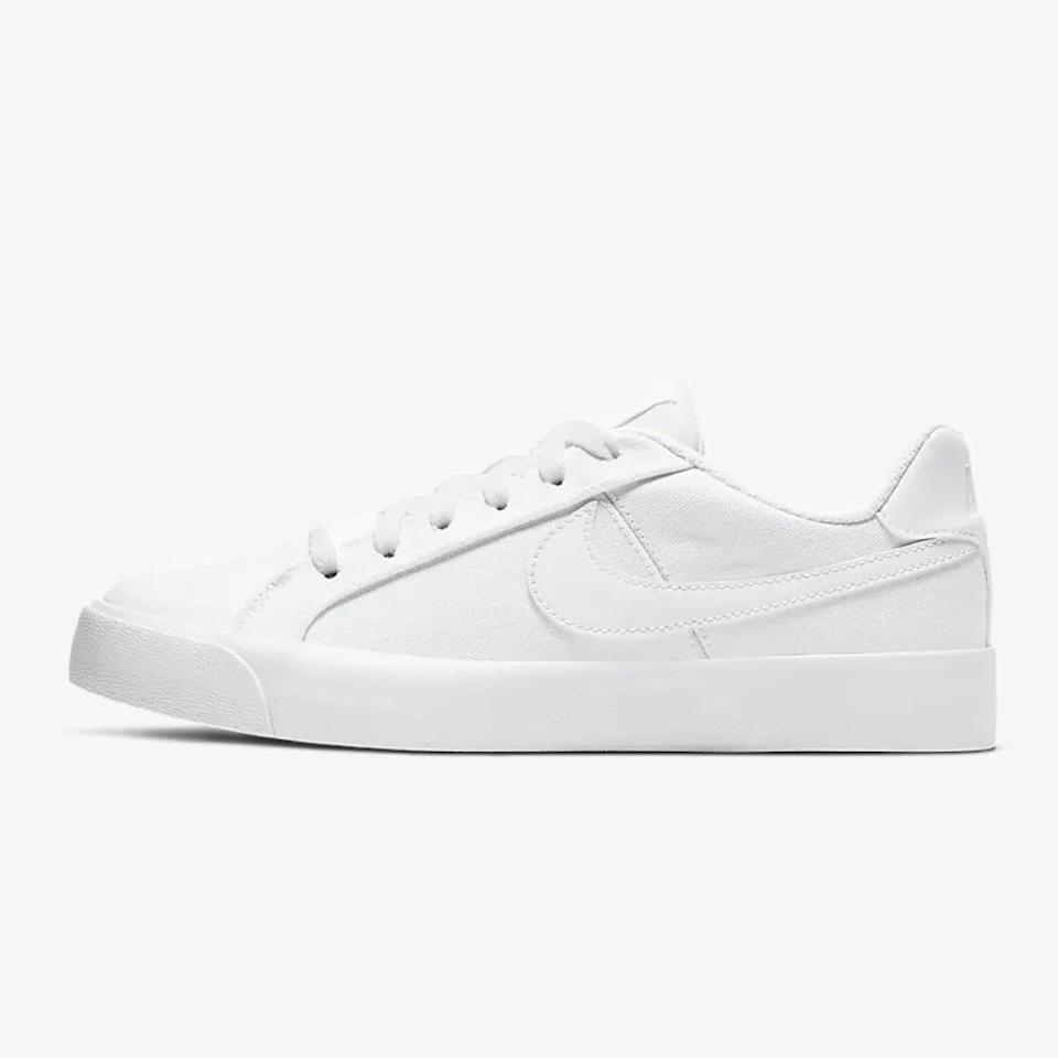 """These sneaks come from Nike's tennis archives and are a classic well worth bringing back. They're good for everyday wear, but the subtle leather details make them structured enough to pair with a semi-dressed-up outfit (hello, <a href=""""https://www.glamour.com/gallery/best-slip-dresses?mbid=synd_yahoo_rss"""" rel=""""nofollow noopener"""" target=""""_blank"""" data-ylk=""""slk:slip dresses"""" class=""""link rapid-noclick-resp"""">slip dresses</a>). $60, Nike. <a href=""""https://www.nike.com/t/court-royale-ac-canvas-womens-shoe-4wTrcs/CD5405-101"""" rel=""""nofollow noopener"""" target=""""_blank"""" data-ylk=""""slk:Get it now!"""" class=""""link rapid-noclick-resp"""">Get it now!</a>"""