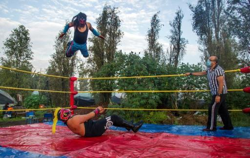 Wrestlers perform in an area called Xochimilco in Mexico City, on August 1, 2020, as rings remain closed due to the COVID-19 coronavirus pandemic