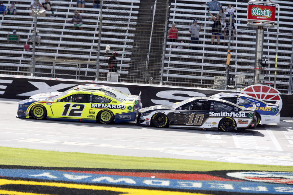Ryan Blaney (12) and Aric Almirola (10) come down the front stretch on a restart during a NASCAR Cup Series auto race at Texas Motor Speedway in Fort Worth, Texas, Sunday, July 19, 2020. (AP Photo/Ray Carlin)