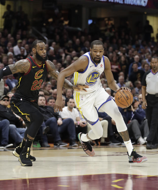 Golden State Warriors' Kevin Durant goes to the basket against Cleveland Cavaliers' LeBron James in the first half of Game 4 of basketball's NBA Finals, Friday, June 8, 2018, in Cleveland. (AP Photo/Tony Dejak)