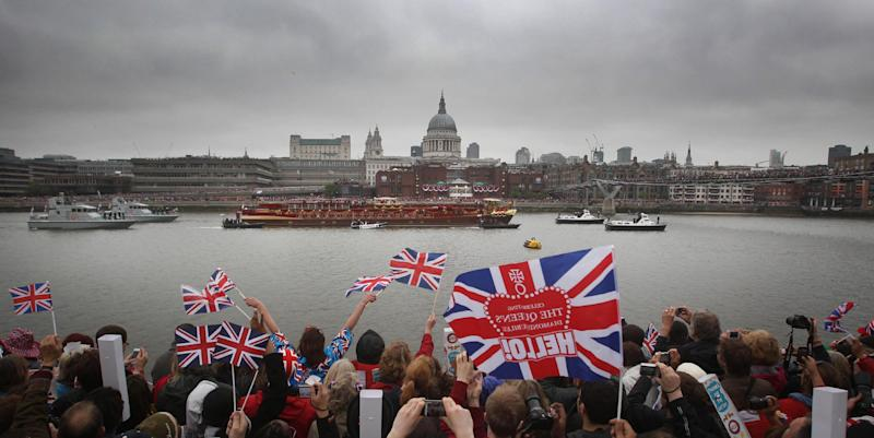 The Royal Barge passes St. Paul's Cathedral during the Diamond Jubilee River Pageant along the River Thames to Tower Bridge, London Sunday June 3, 2012. More than 1,000 boats will sail down the River Thames on Sunday in a flotilla tribute to Queen Elizabeth II's 60 years on the throne that organizers are calling the biggest pageant on the river for 350 years. (AP Photo/Lewis Whyld, PA) UNITED KINGDOM OUT