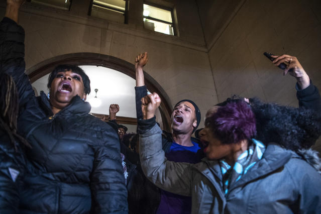 People, including Khalil Darden, 18, of Penn Hills, Pa., center, and Pennsylvania State Rep. Summer Lee, right, protest after they learned a not guilty verdict in the homicide trial of former East Pittsburgh police Officer Michael Rosfeld, Friday, March 22, 2019, at the Allegheny County Courthouse in downtown Pittsburgh, Pa. A jury acquitted Rosfeld, a former police officer Friday in the fatal shooting of Antwon Rose II, an unarmed teenager as he was fleeing a high-stakes traffic stop outside Pittsburgh, a confrontation that was captured on video and led to weeks of unrest. (Alexandra Wimley/Pittsburgh Post-Gazette via AP)