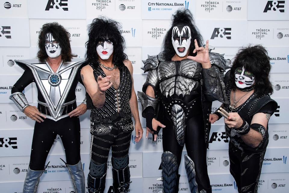 """Kiss members Tommy Thayer, left, Paul Stanley, Gene Simmons and Eric Singer attend the premiere of A&E Network's """"Biography: KISStory"""" during the 20th Tribeca Festival at New York's Battery Park on Friday."""