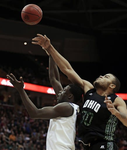 Ohio' Reggie Keely, right, tries to block a shot by Akron's Demetrius Treadwell during the first half of an NCAA college championship basketball game in the Mid-American Conference tournament Saturday, March 16, 2013, in Cleveland. (AP Photo/Tony Dejak)