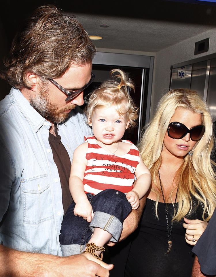 <p>An expectant Jessica Simpson and her fiancé, Eric Johnson, had a very cute piece of carry-on luggage with them when they arrived at Los Angeles International Airport on Monday: daughter Maxwell! The little girl, who just turned 1, will become a big sister in July. (5/6/2013)</p>