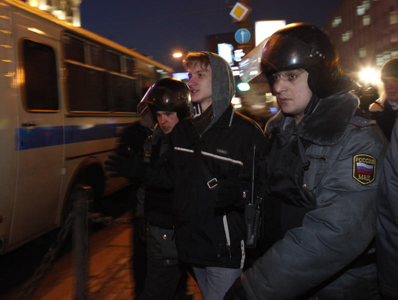 Russian police officers detain an opposition activist to prevent a demonstration on Pushkin Square in Moscow, Russia, Tuesday, March 6, 2012. Russian Prime Minister Vladimir Putin rejected opposition protests against his presidential election victory Tuesday and his Foreign Ministry ruled out any softening of Moscow's stance on Syria, a strong indication that the Russian leader has no intention of easing tough policies either at home or abroad. (AP Photo/Alexander Zemlianichenko)