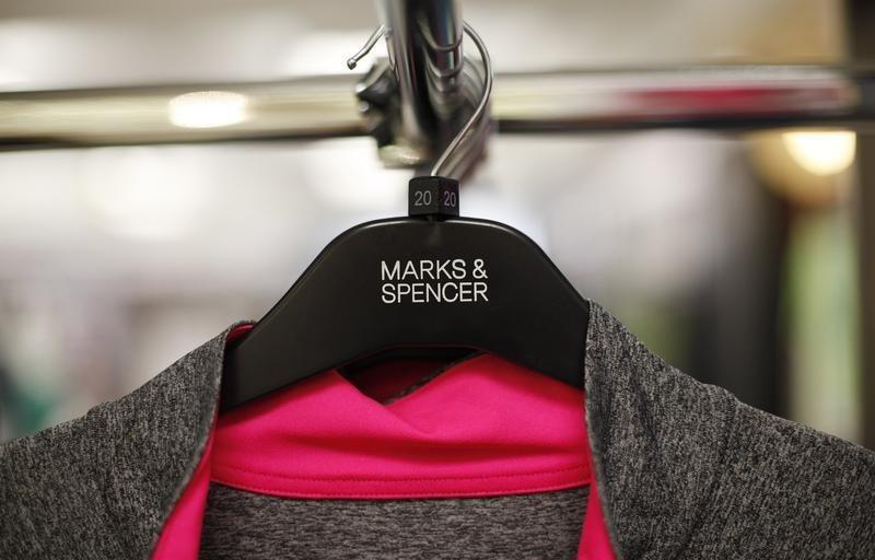Clothes are displayed on hangers in an M&S shop in northwest London July 8, 2014. REUTERS/Suzanne Plunkett