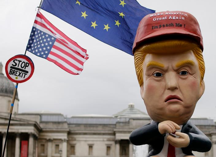 A robotic likeness of President Trump on a golden toilet in Trafalgar Square on June 4. (Photo: Tim Ireland/AP)