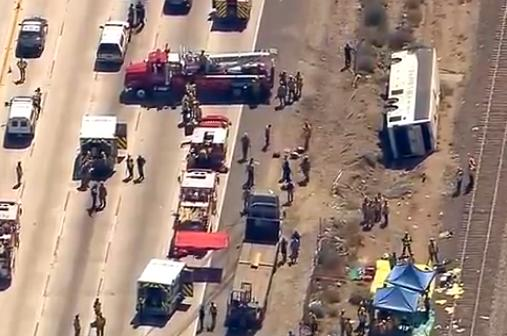 This video image provided by KABC-TV shows rescue officials working the scene of an accident where a tour bus, left, crashed and turned over injuring multiple passengers Thursday Aug. 22, 2013 in Los Angeles. Los Angeles County fire officials say 50 people have been injured in the tour bus crash along a Southern California freeway. (AP Photo/KABC-TV)