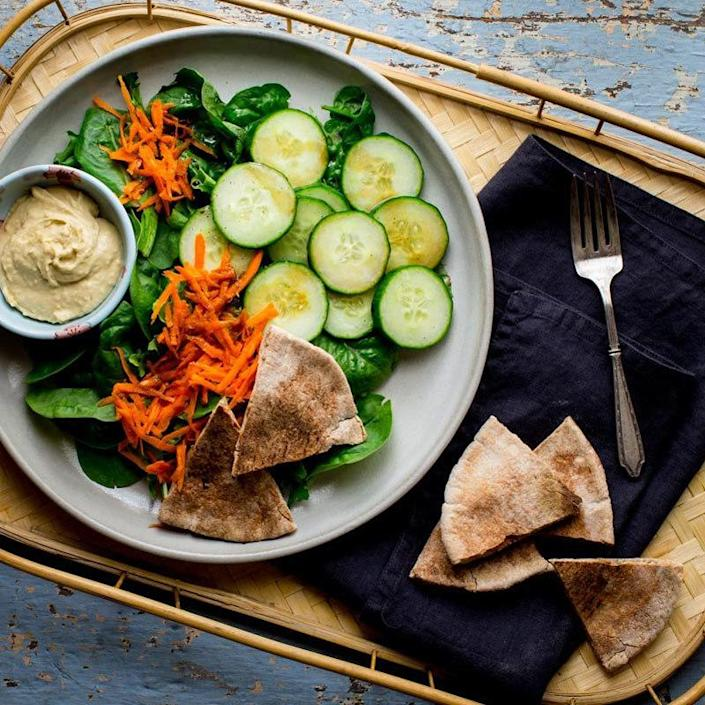 <p>Elevate hummus and pita by piling your plate high with cucumbers, carrots and mixed greens! Just a drizzle of balsamic vinegar and extra-virgin olive oil is all it takes to dress it up.</p>