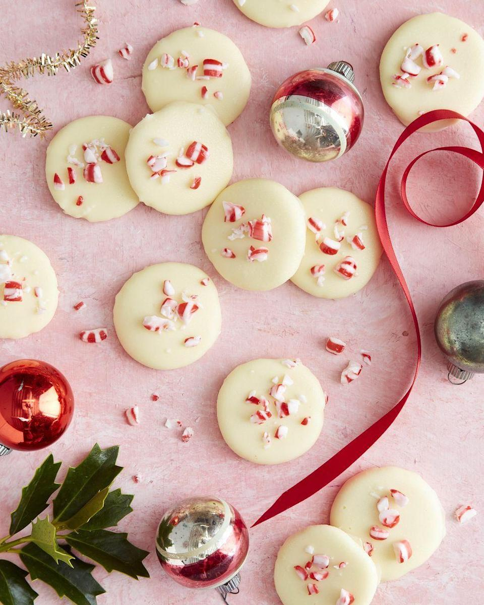 """<p>Pretty as a picture and absolutely delish, these DIY peppermint patties will make a yummy hostess gift for even virtual holiday parties!</p><p><strong><a href=""""https://www.countryliving.com/food-drinks/a34330428/white-chocolate-peppermint-patties-recipe/"""" rel=""""nofollow noopener"""" target=""""_blank"""" data-ylk=""""slk:Get the recipe"""" class=""""link rapid-noclick-resp"""">Get the recipe</a>.</strong></p><p><a class=""""link rapid-noclick-resp"""" href=""""https://www.amazon.com/Nielsen-Massey-Pure-Peppermint-Extract-ounces/dp/B00194F1UA/ref=sr_1_2?tag=syn-yahoo-20&ascsubtag=%5Bartid%7C10050.g.645%5Bsrc%7Cyahoo-us"""" rel=""""nofollow noopener"""" target=""""_blank"""" data-ylk=""""slk:SHOP PEPPERMINT EXTRACT"""">SHOP PEPPERMINT EXTRACT</a> </p>"""