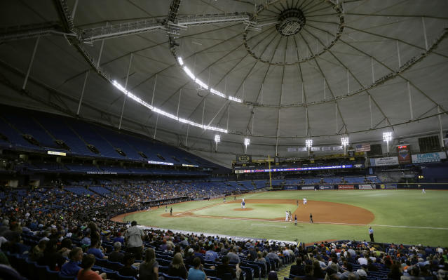 File-This Aug. 29, 2017, file photo shows the Houston Astros playing the Texas Rangers during the third inning of a baseball game at Tropicana Field in St. Petersburg, Fla. The mayor of St. Petersburg says the city will not allow the Tampa Bay Rays to pursue a plan to split home games between new stadiums that would be built in Florida and Montreal. Mayor Rick Kriseman informed the City Council in a memo Wednesday, Dec. 4, 2019, that he and the team agree that the best path forward is to abide by an existing contract that requires the Rays to play at Tropicana Field through 2027. (AP Photo/Chris O'Meara, File)