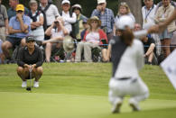 Lizette Salas of the United States, left, and Korea's Ko Jin-young wait to putt on the 16th green during the final round of the Women's British Open golf championship at Woburn Gold Club near near Milton Keynes, England, Sunday, Aug. 4, 2019. (AP Photo/Tim Ireland)
