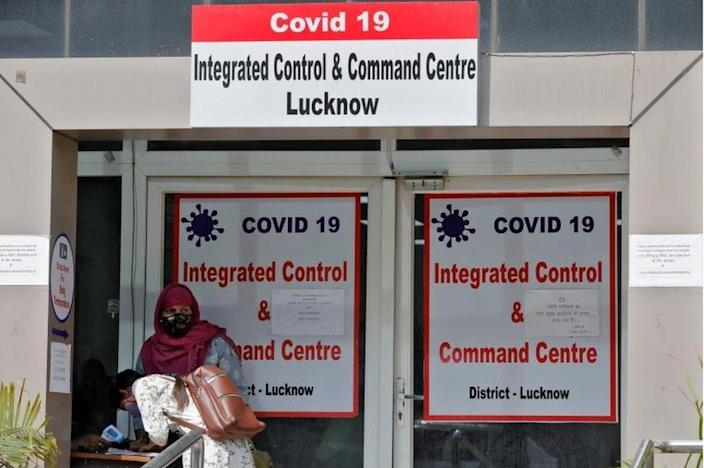 A woman registers details to get a hospital bed for her relative who needs treatment for the coronavirus disease at the COVID-19 Integrated Control and Command Centre in Lucknow, India, April 20, 2021.