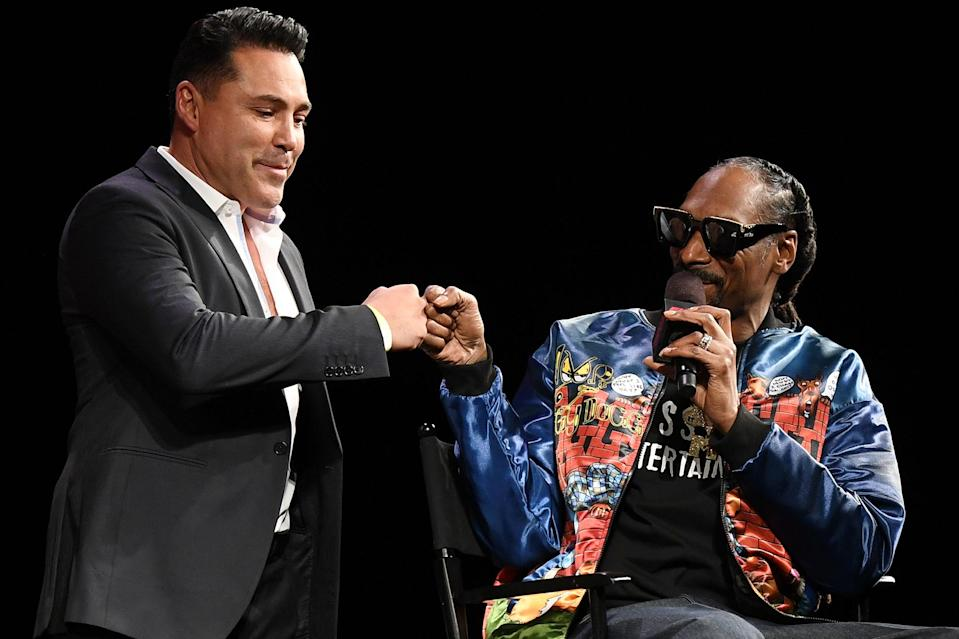 <p>Oscar De La Hoya and Snoop Dogg shared a moment on stage during a news conference for Triller Fight Club's inaugural 2021 boxing event at The Venetian in Las Vegas.</p>