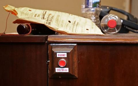 A piece of furniture with an attached 'PANIC' button sits in the Roosevelt Room during rennovation work at the White House August 11, 2017 in Washington, DC - Credit: Getty
