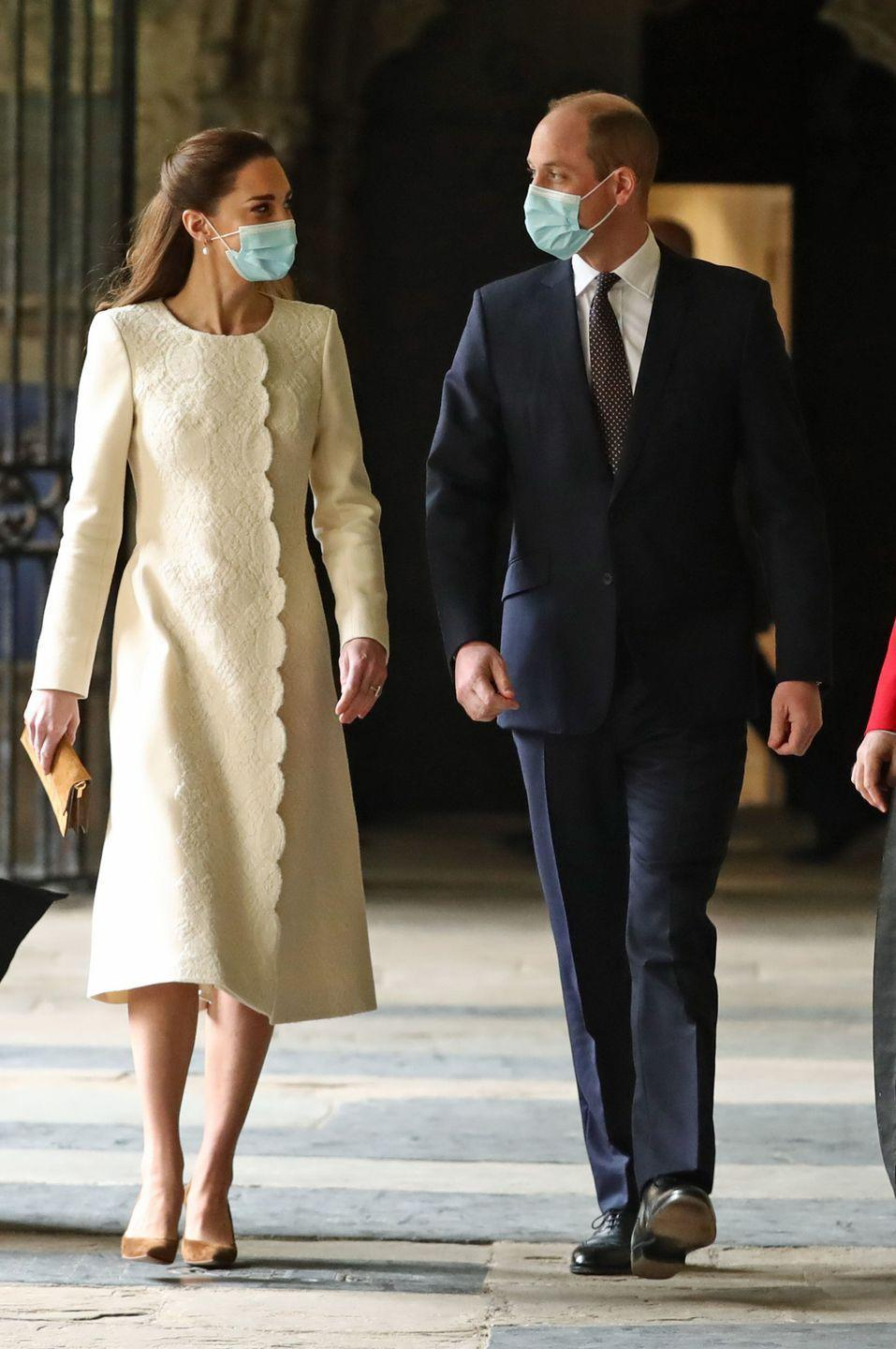 <p>Kate picked a long-sleeved cream dress with lace and scallop detailing during an appearance at Westminster Abbey's COVID-19 vaccination center.</p>