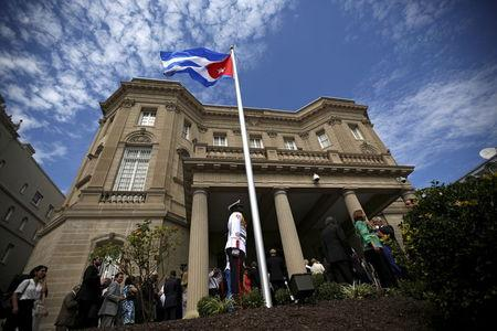 Guard stands in front of the new Cuban embassy in Washington after officials raised the national flag in a ceremony