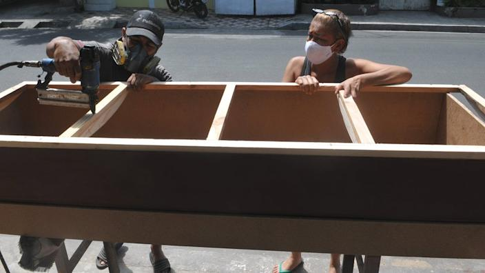 A furniture-maker and his wife are now making desperately needed coffins