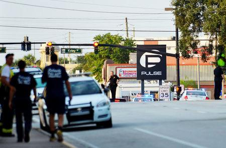 FILE PHOTO --  Police lock down Orange Avenue around Pulse nightclub, where people were killed by a gunman in a shooting rampage in Orlando, Florida June 12, 2016.  REUTERS/Kevin Kolczynski/File Photo