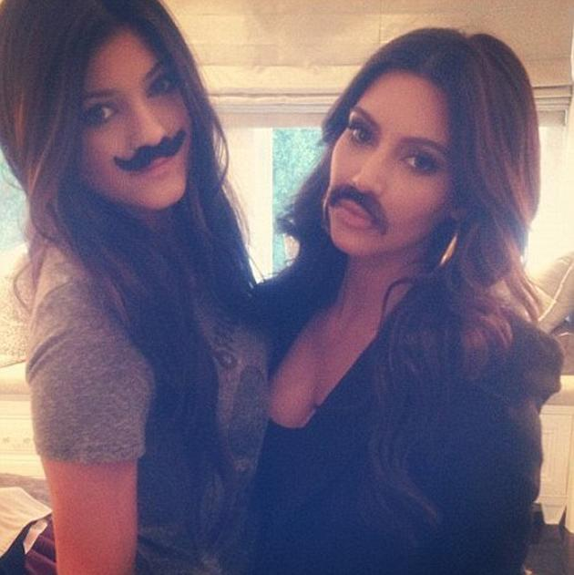 """Celebrity photos: Kim Kardashian and her sister Kylie tweeted this picture of themselves sporting fake moustaches. Kim revealed the comedienne in her with the caption: """"I mustache you a question...but I'll shave it for later."""""""