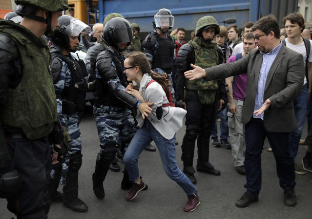 <p>A young girl reacts after her friend was detained by police during a demonstration in downtown Moscow, Russia, Monday, June 12, 2017. (Pavel Golovkin/AP) </p>
