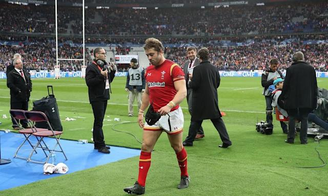 """<span class=""""element-image__caption"""">A dejected Leigh Halfpenny leaves the Stade de France pitch after Wales' dramatic defeat against France.</span> <span class=""""element-image__credit"""">Photograph: David Davies/PA</span>"""