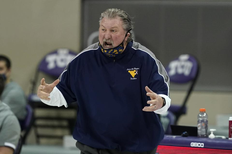 West Virginia head coach Bob Huggins shouts at an official during the second half of an NCAA college basketball game against TCU in Fort Worth, Texas, Tuesday, Feb. 23, 2021. (AP Photo/Tony Gutierrez)
