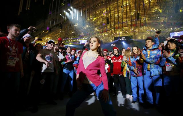 A participant dances during the party at the end of the closing ceremony for the Sochi 2014 Winter Olympics, February 23, 2014. REUTERS/Marko Djurica (RUSSIA - Tags: SPORT OLYMPICS)